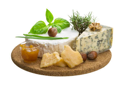 Assorted cheese - brie, dor blue and hard old yellow cheese photo