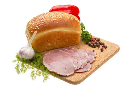 Ripe fresh ham with vegetables and bread photo