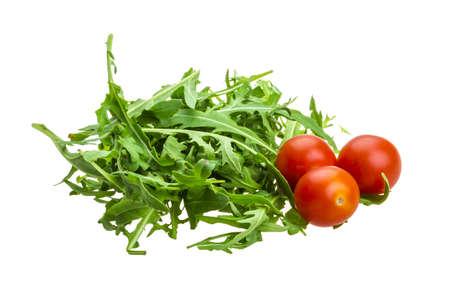 tomato cherry: Ruccola with tomato cherry isolated Stock Photo
