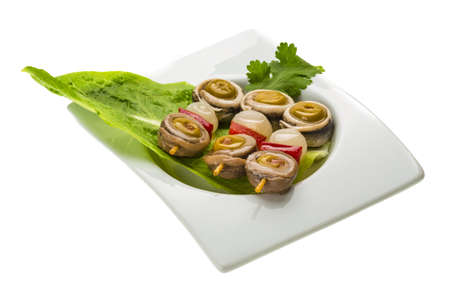 Anchovy rolls with onion, pepper and olives photo