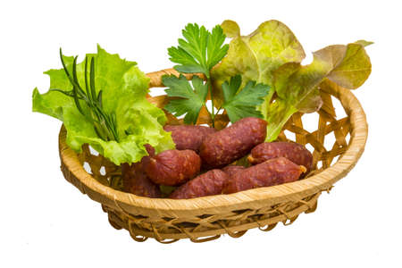 Salami sausages with salad and herbs photo