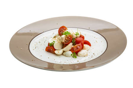 Italoan salad Caprese isolated on white photo