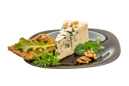 Mould cheese with cress-salad, nuts and crisp photo