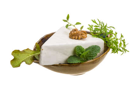 Brie cheese with herbs isolated photo