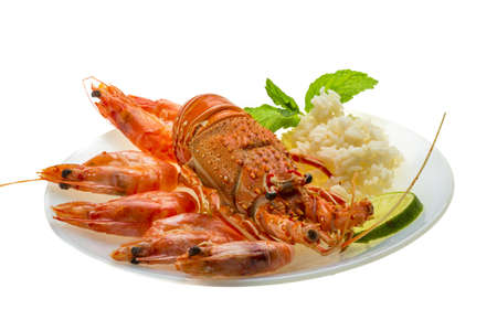 Spiny lobster, shrimps and rice photo