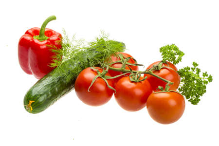 Red ripe tomatoes on the branch with parsley, dill, cucumber and pepper photo