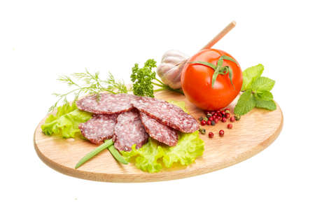 Fresh ripe salami with vegetables photo