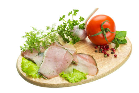 Ripe fresh ham with vegetables photo