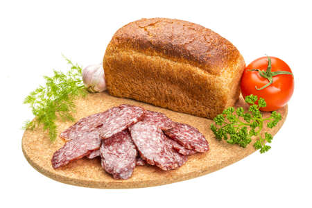 Fresh salami with bread and vegetables photo
