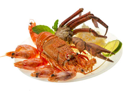Spiny lobster, shrimps, crab legs  and rice photo