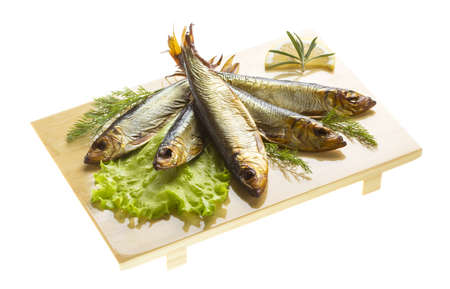 Smoked sprat - appetizing snack photo