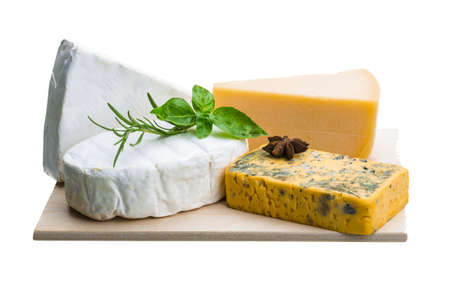 Variety cheese assortment with nuts and herbs photo