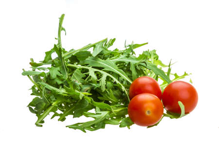 ruccola: Ruccola with tomato cherry isolated Stock Photo
