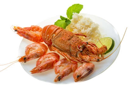 langouste: Spiny lobster, shrimps and rice Stock Photo