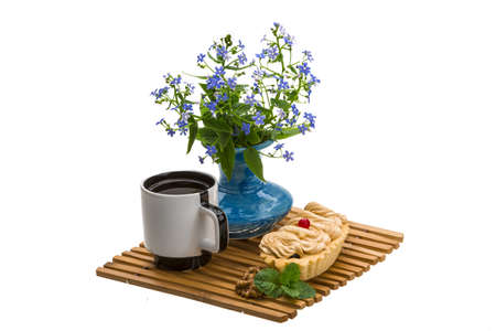 Coffee with cake and flowers photo