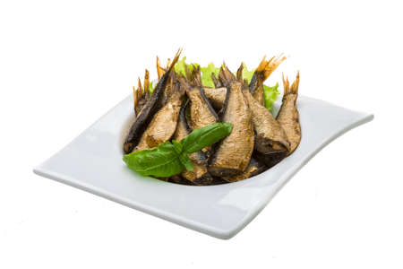 Sprats with basil macro isolated photo