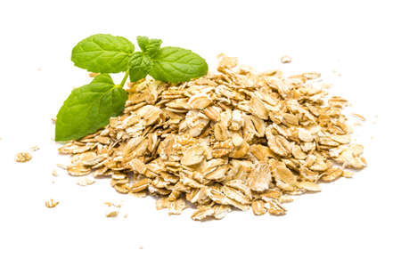 Oats pile with mint branch