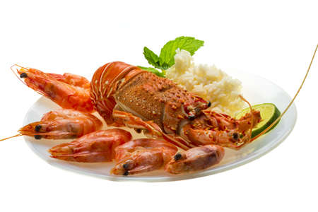 decapods: Spiny lobster, shrimps and rice Stock Photo