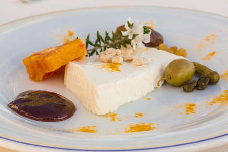 Sheep cheese with herbs, fruits and nut photo