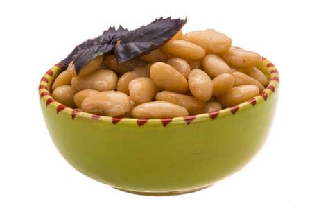 tinned: Tinned bean with basil leaf Stock Photo