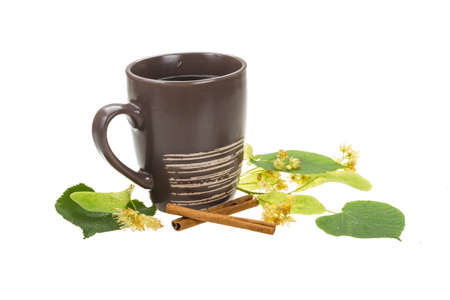 Linden tea with cinnamon isolated photo