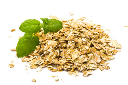Oats pile with mint branch photo
