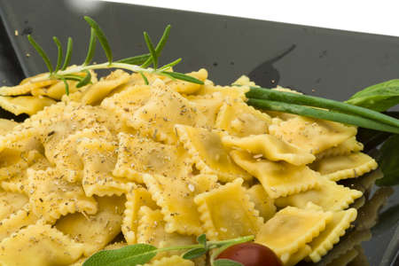italian Ravioli with herbs isolated