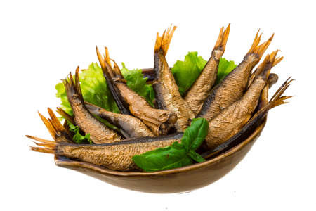 Tinned sprats with basil branch photo