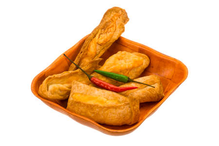 Pastries with cheese and chilli pepper isolated photo