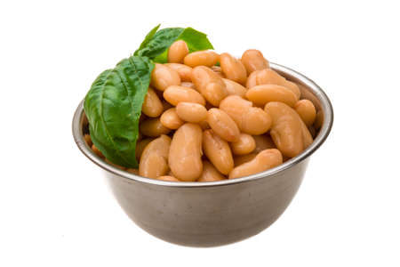 pinto beans: Tinned bean with basil leaf Stock Photo