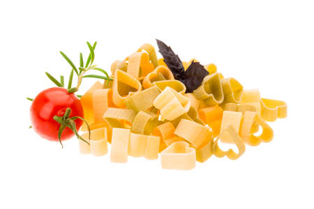 Macaroni - hearts of various color with rosemary and basil photo