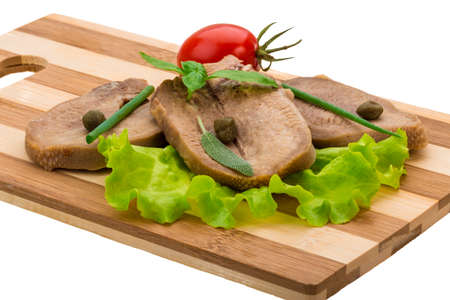 Beef tongue with herbs isolated photo