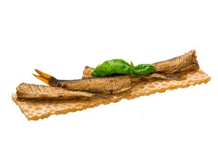 Sprats with basil macro isolated photo