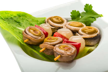engraulis encrasicolus: Anchovy rolls with onion, pepper and olives