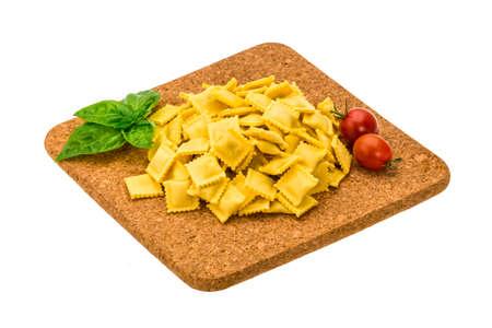 italian Ravioli with herbs isolated photo