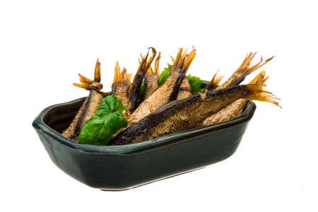 Tinned sprat with basil branch photo