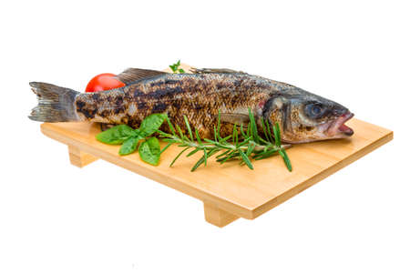 Roasted seabass with rosemary and herbs photo
