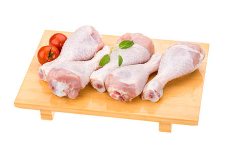 Raw chicken legs ready for cooking photo