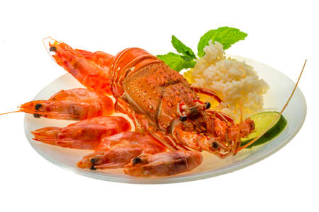palinuridae: Spiny lobster, shrimps and rice Stock Photo