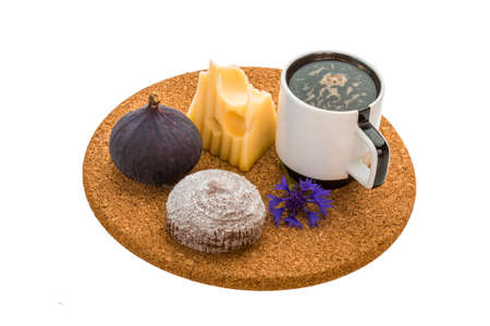 Breakfast with coffee, cake, fig, cheese and flower photo