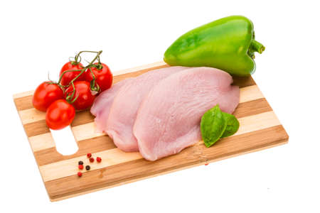 Turkey raw steak with pepper and tomato photo