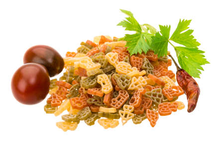 Macaroni - various color with herbs and tomato photo
