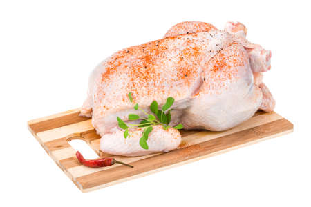 Raw chicken with paprika and herbs Stock Photo
