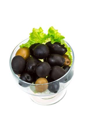 Olives with salad leaf photo