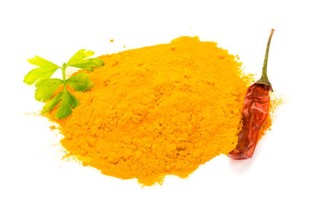 Curry powder isolated heap photo