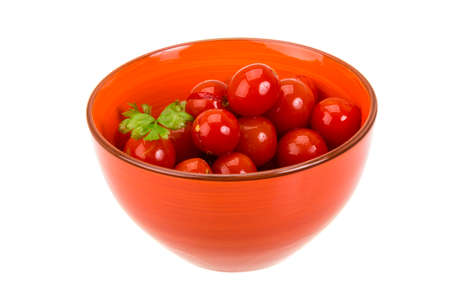 Marinated cherry tomato isolated photo