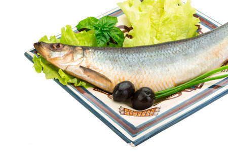 Salted Herring with salad and herbs photo