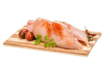 Raw chicken fillet with spices photo