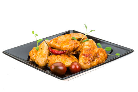 Grilled chicken wings with sage and pepper photo