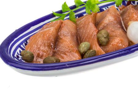 Sliced herring in paprica sauce photo